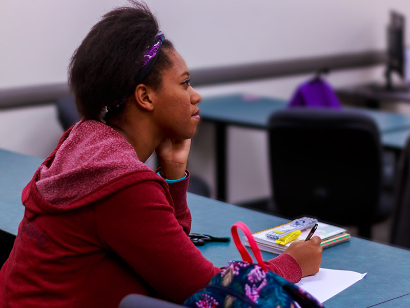 Student listening intently during a lecture at Tulane School of Professional Advancement in New Orleans, LA