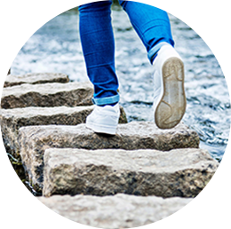 A person walking on stone steps representing Tulane School of Professional Advancement's Health and Wellness minor program in New Orleans, LA