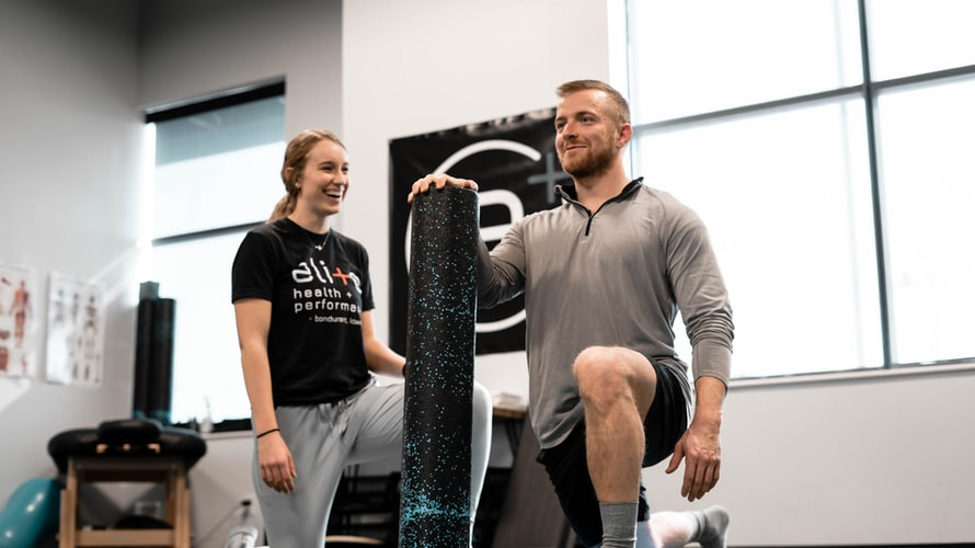 Athlete working with trainer for sports medicine - Tulane School of Professional Advancement