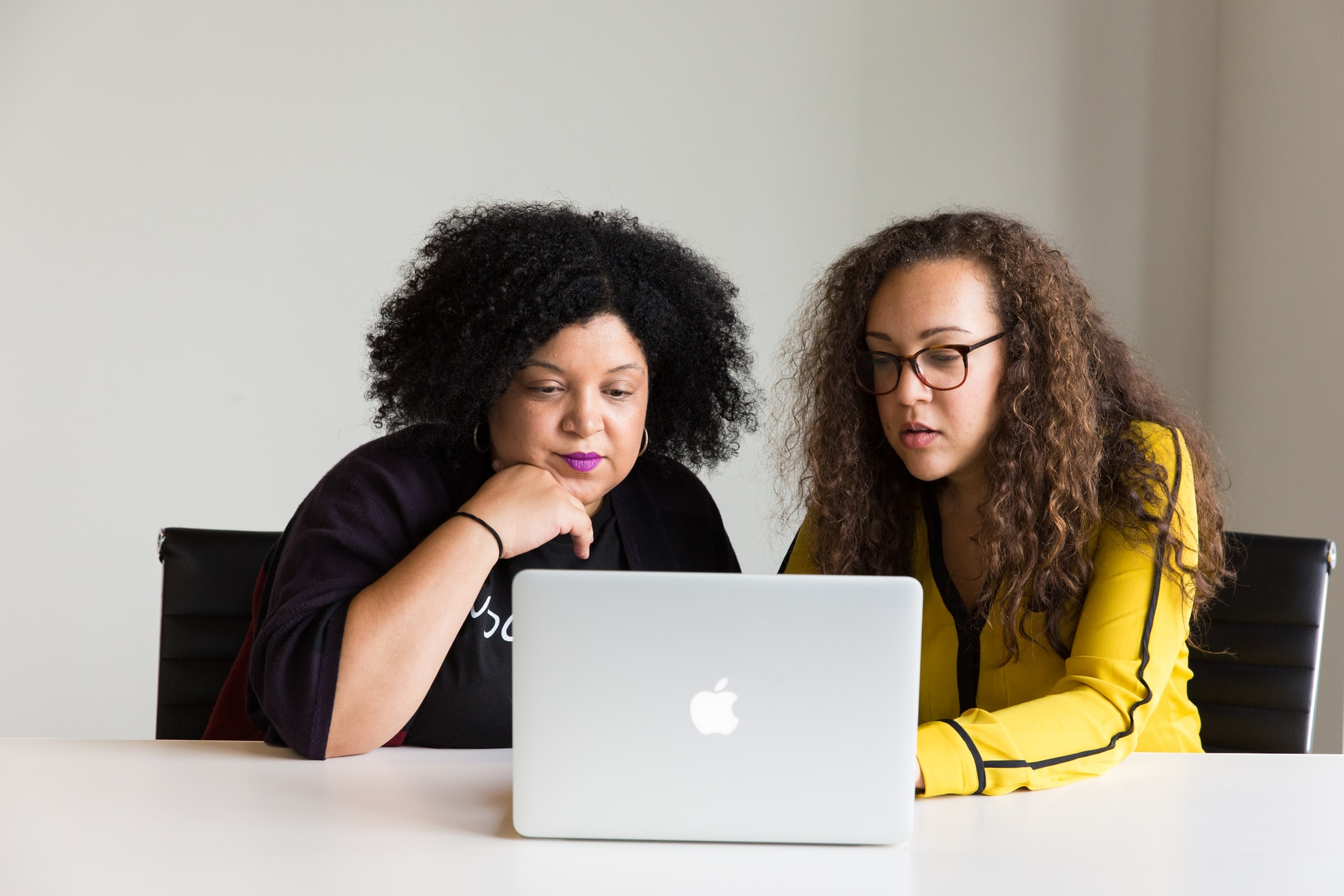 Two women looking at a laptop screen - Tulane School of Professional Advancement