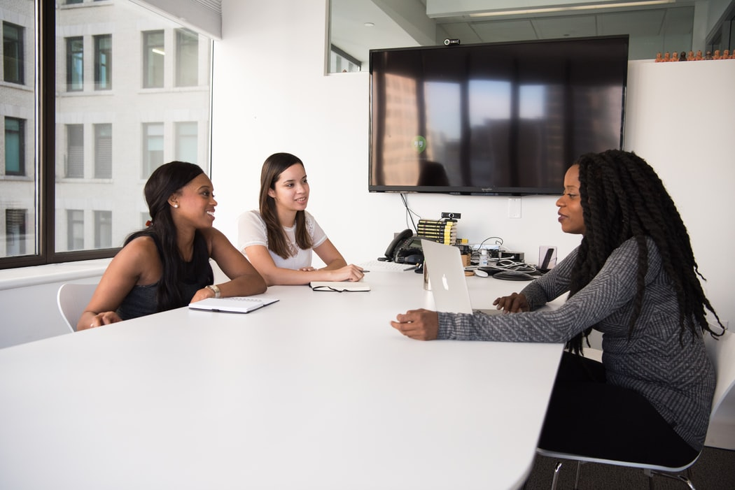 A group of people during a meeting in a conference room
