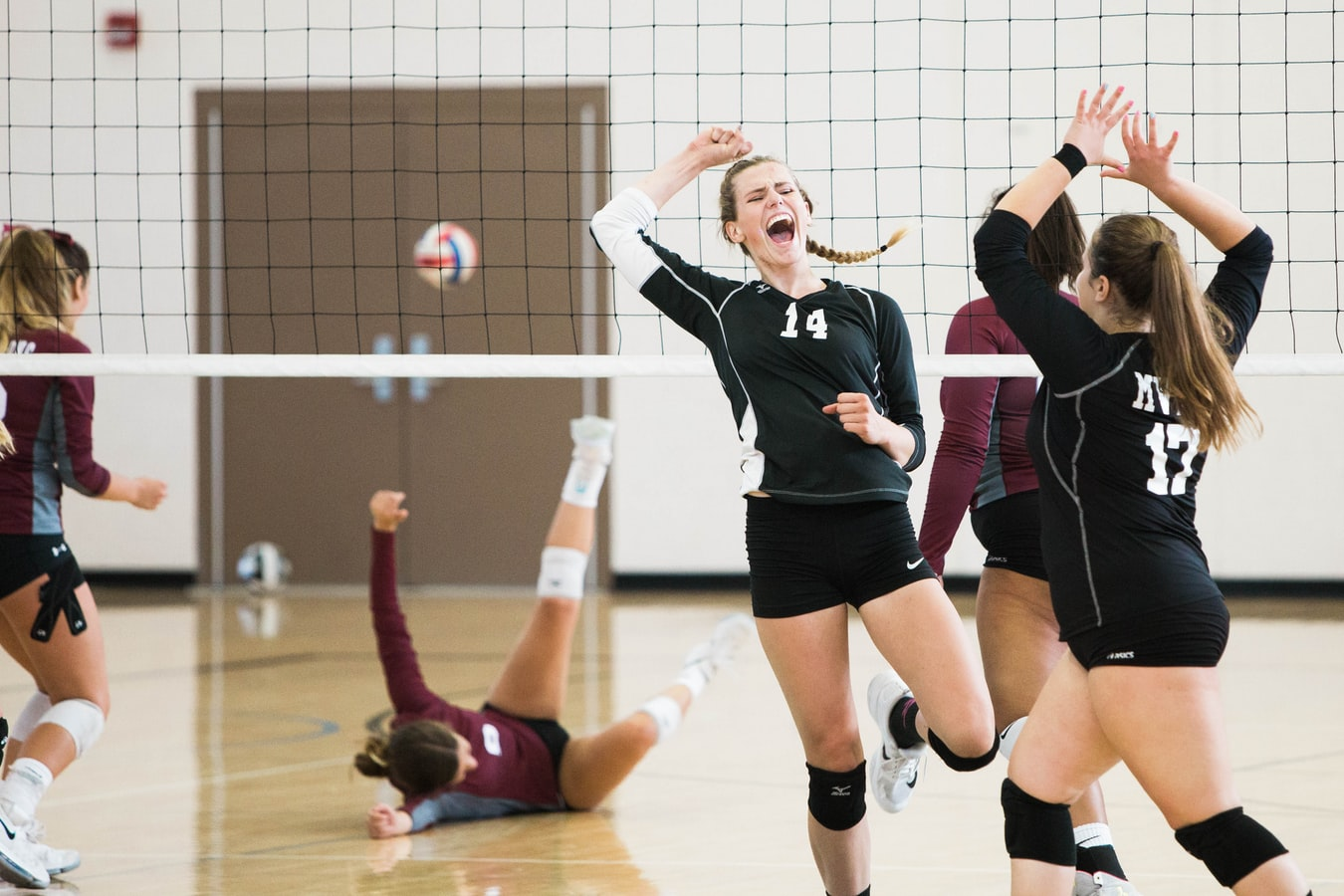 Volleyball players celebrate crushing the opposition
