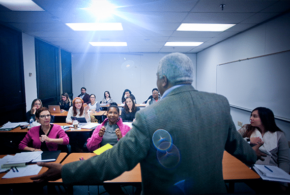 Professor teaching Emergency Management students in class - Tulane School of Professional Advancement