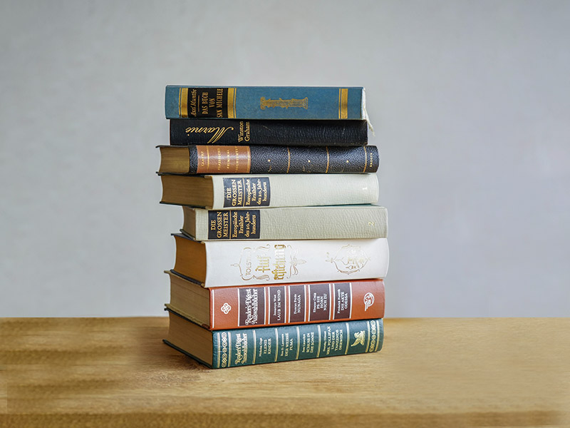 A stack of eight literary works representing what students will study in Tulane School of Professional Advancement's Master of Liberal Arts program in New Orleans, LA