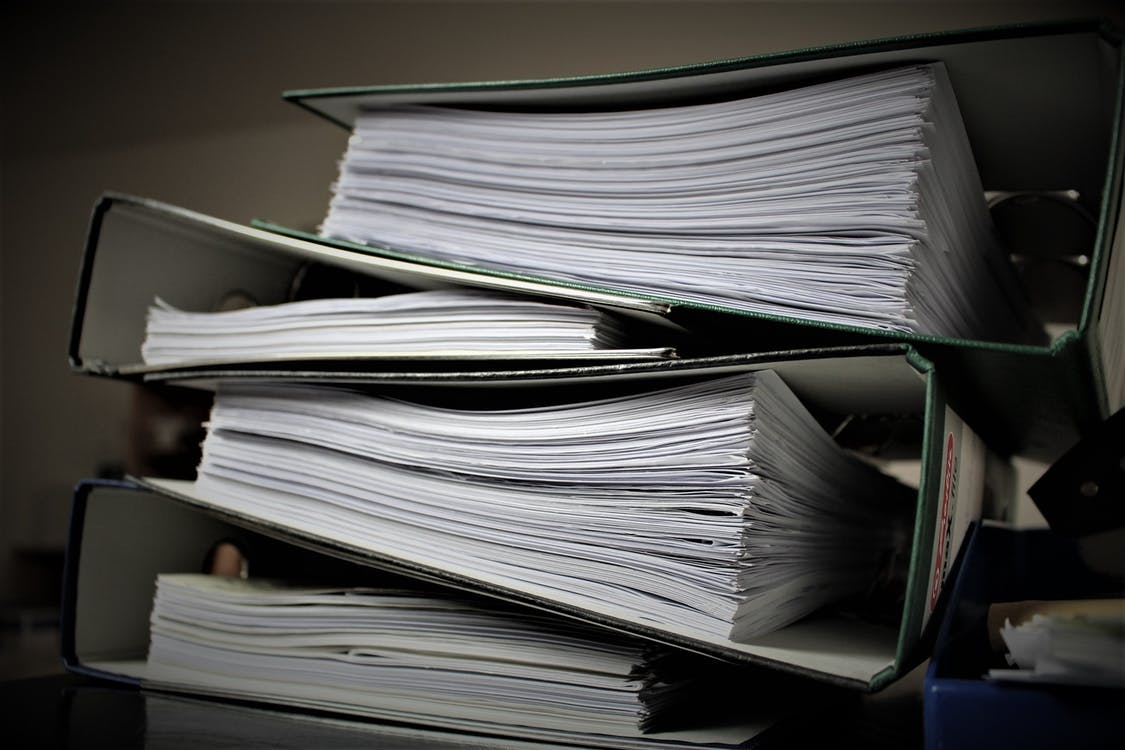 Stack of binders - Tulane School of Professional Advancement
