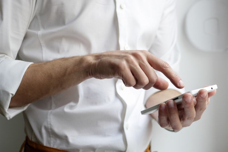 A business person using a smartphone