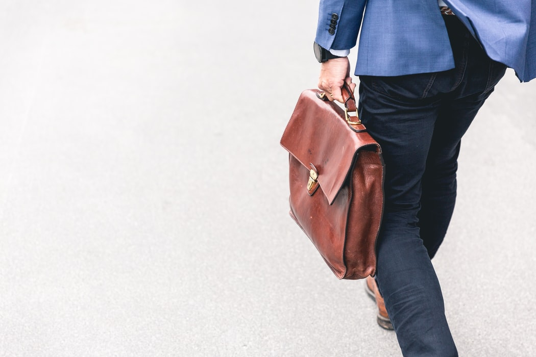 A person carrying a briefcase