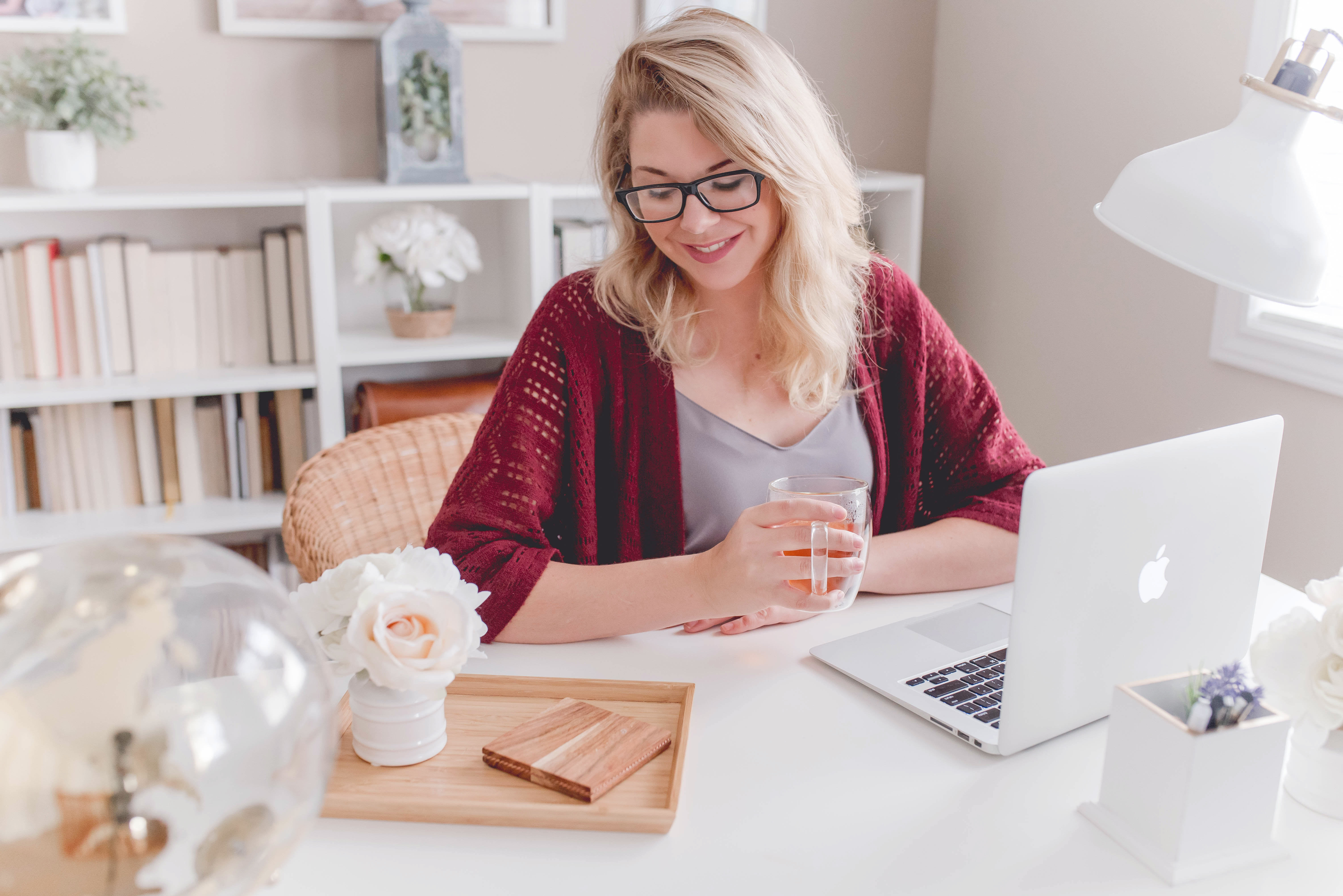 A woman smiling at her home desk