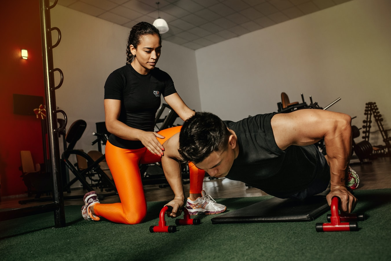 An athletic trainer working with a client