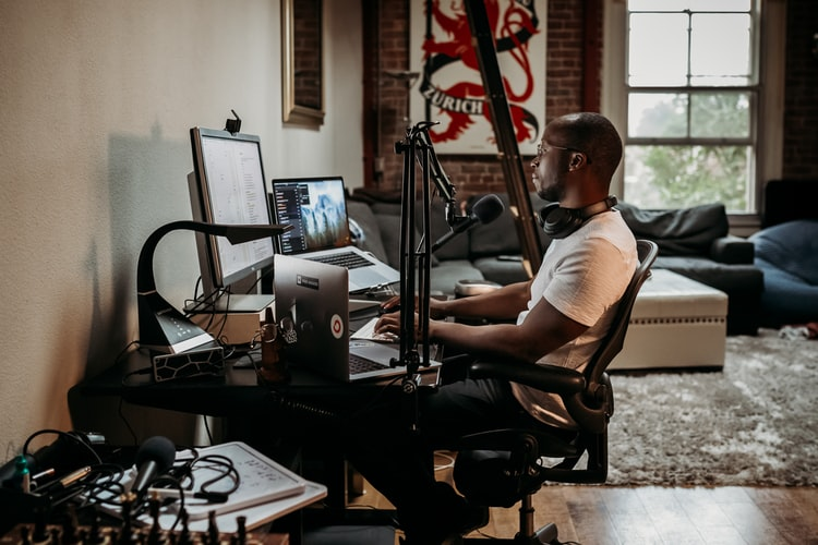 A professional working from home using tech equipment