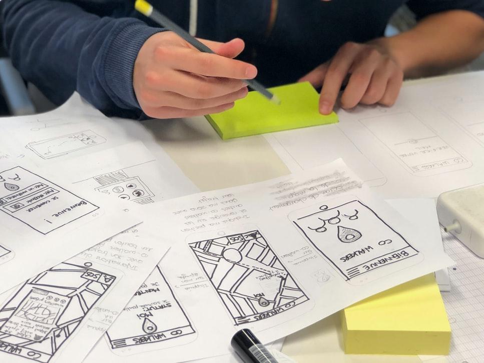 A person sketching UX mockups