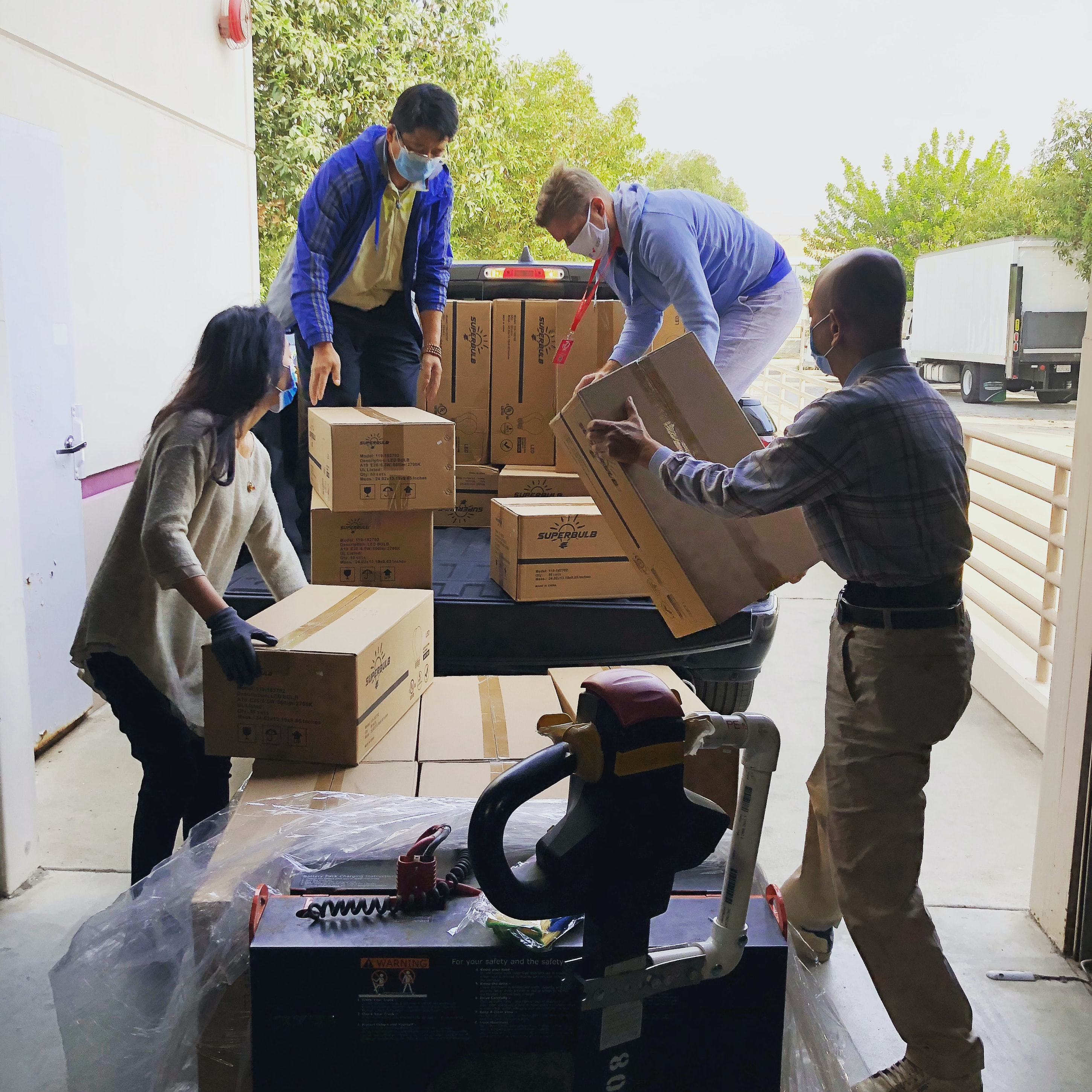 Nonprofit workers loading up a truck