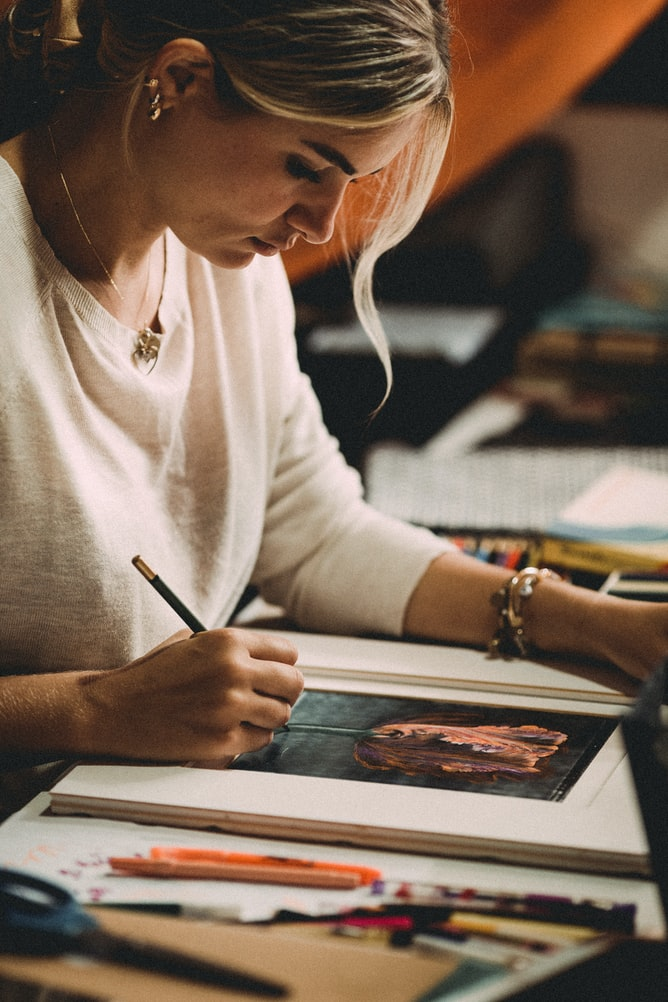 A girl working on a piece of art