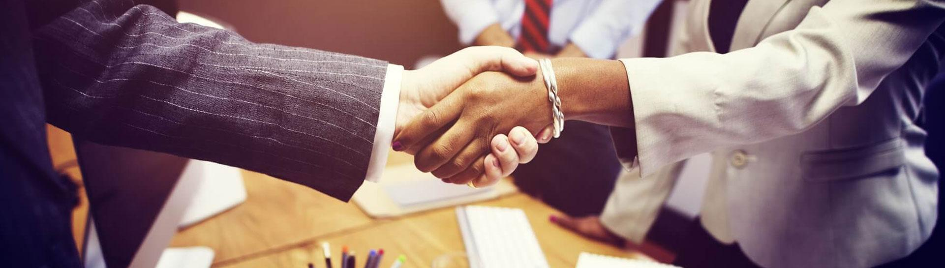 College Graduate Shaking Hands with Employer