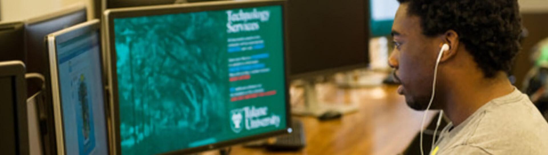 A student working on a computer representing Tulane School of Professional Advancement's information technology degree program in New Orleans, LA