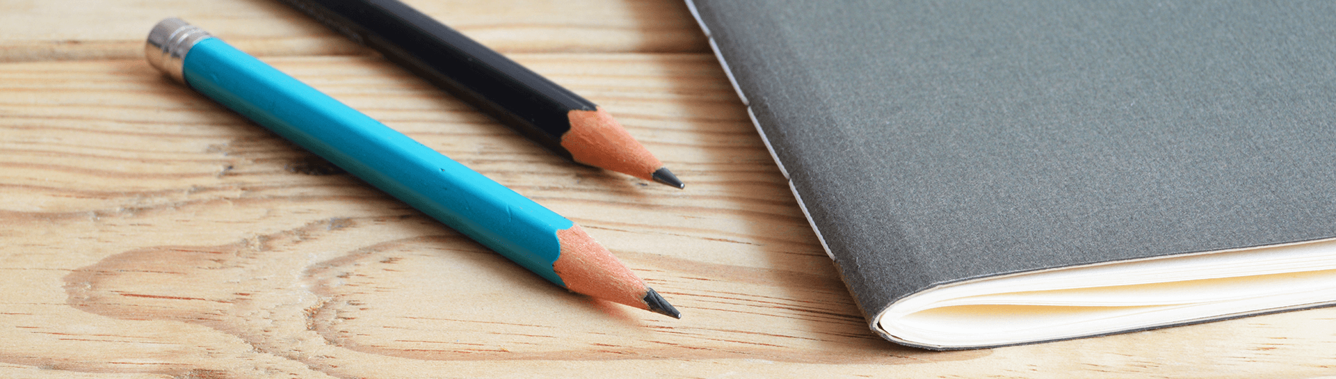 Pencils next to a notebook