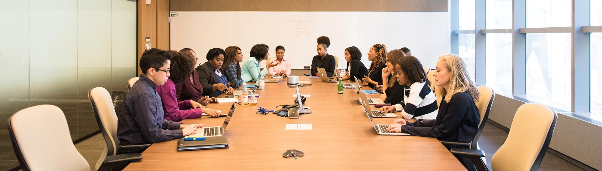 A group of professionals sitting at a conference room table