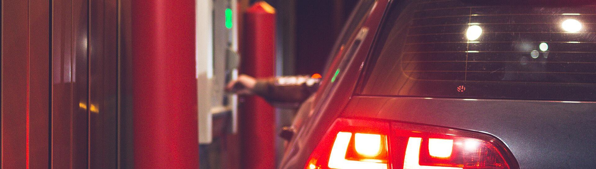 A person in their car using an ATM
