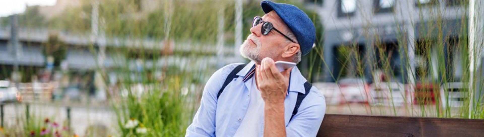 A vision impaired man uses a smartphone.