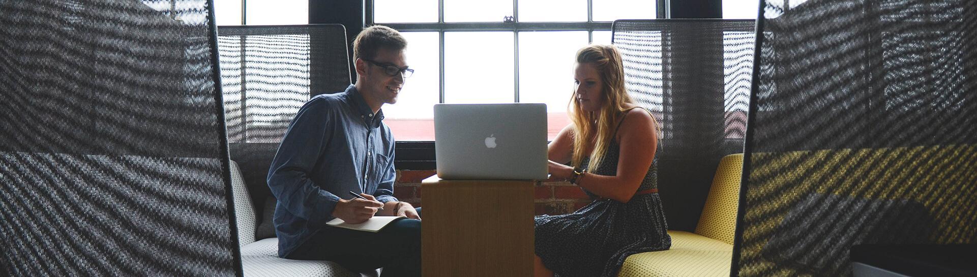 Digital Marketing students looking at laptop - Tulane School of Professional Advancement