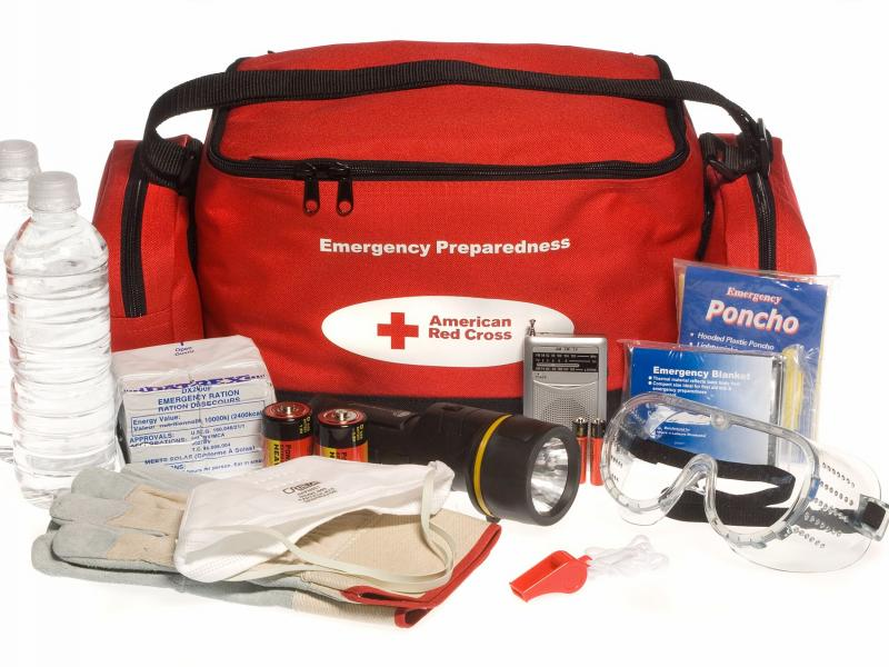 Red cross bag with emergency supplies for hurricane preparation