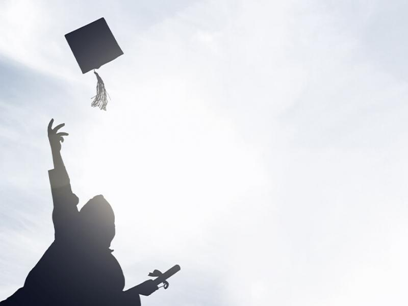 Graduate throwing cap