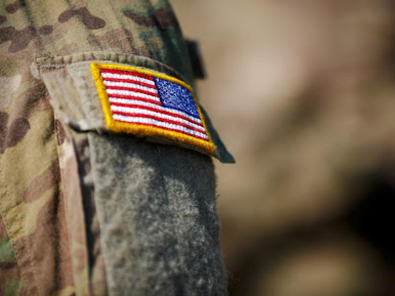 A military uniform with an American flag patch