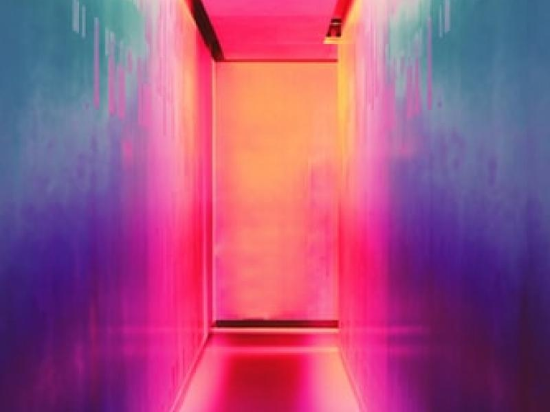 A colorfully-lit hallway
