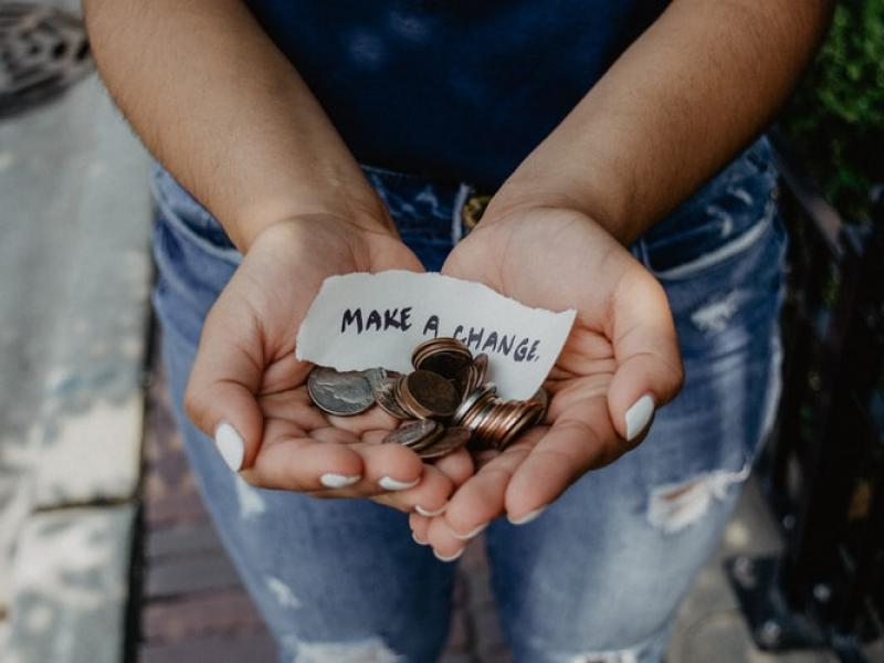 Hands holding change and a note that states 'Make a change'