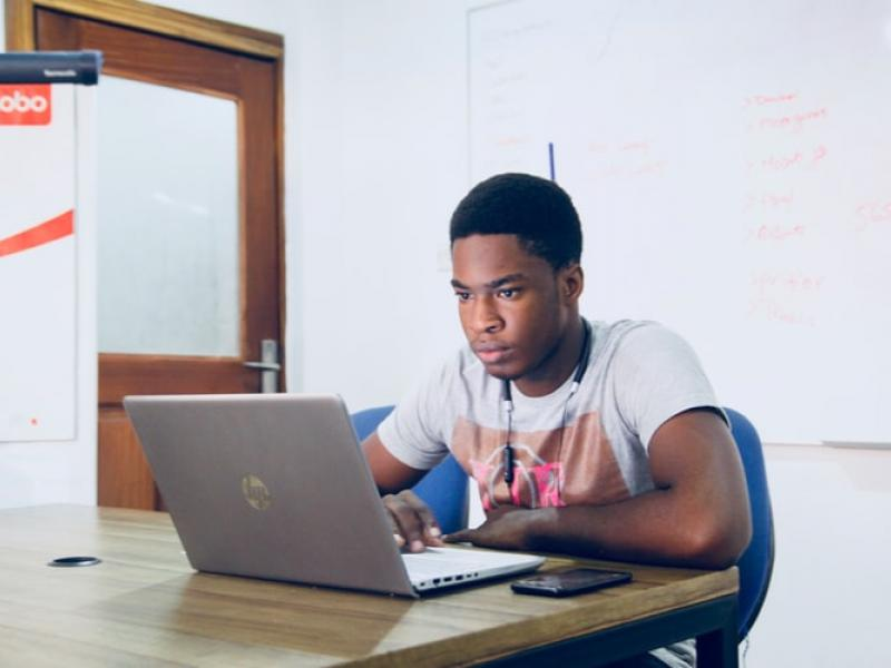 A student using their laptop in a classroom