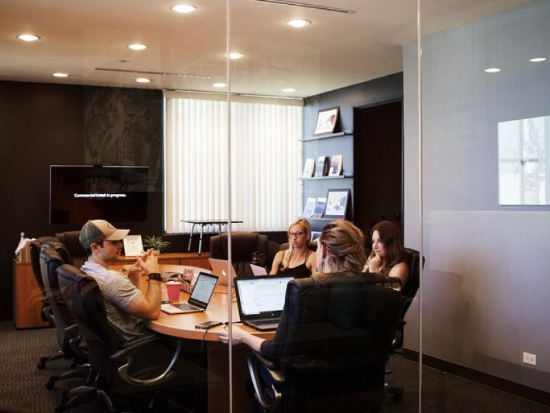 A group of people working in a conference room