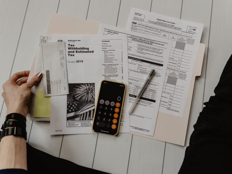 A person with a folder of financial documents