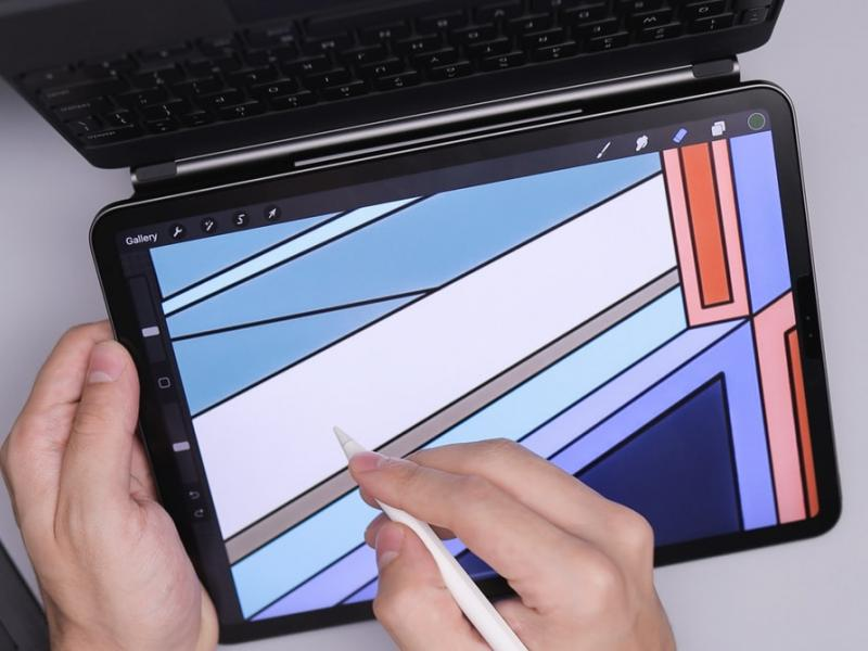 A person designing on a tablet